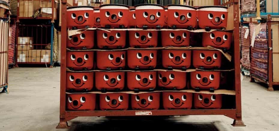 Completed Henry vacuum cleaner bottoms on a pallet inside the parts warehouse, ready to be assembled