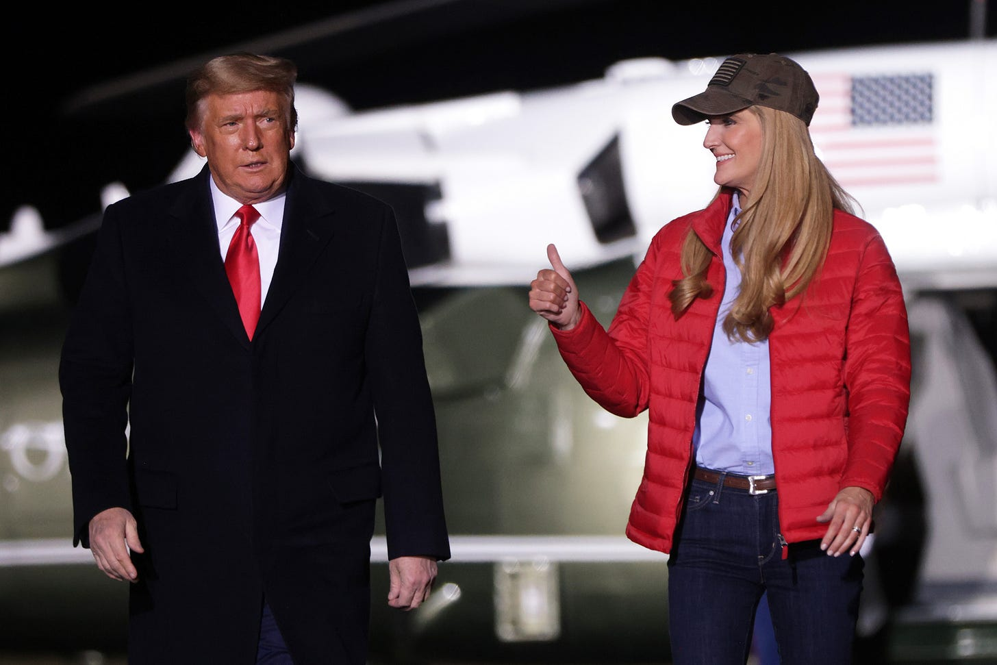 U.S. President Donald Trump arrives with Sen. Kelly Loeffler (R-GA) at a campaign rally at Dalton Regional Airport January 4, 2021 in Dalton, Georgia. Trump campaigned for Loeffler and Sen. David Perdue (R-GA) ahead of tomorrow's run-off elections in Georgia. (Photo by Alex Wong/Getty Images)
