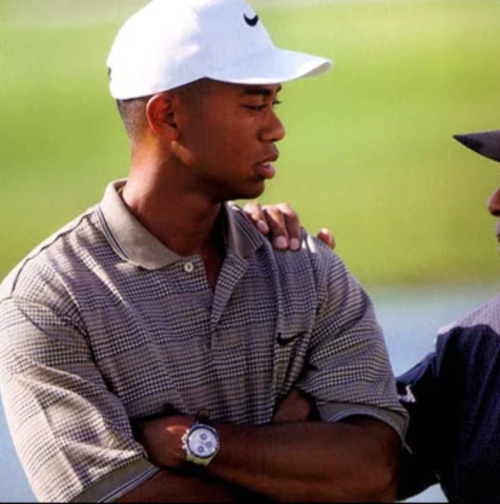 """A younger Tiger Woods wearing a limited edition """"Tudor Tiger"""" chronograph"""