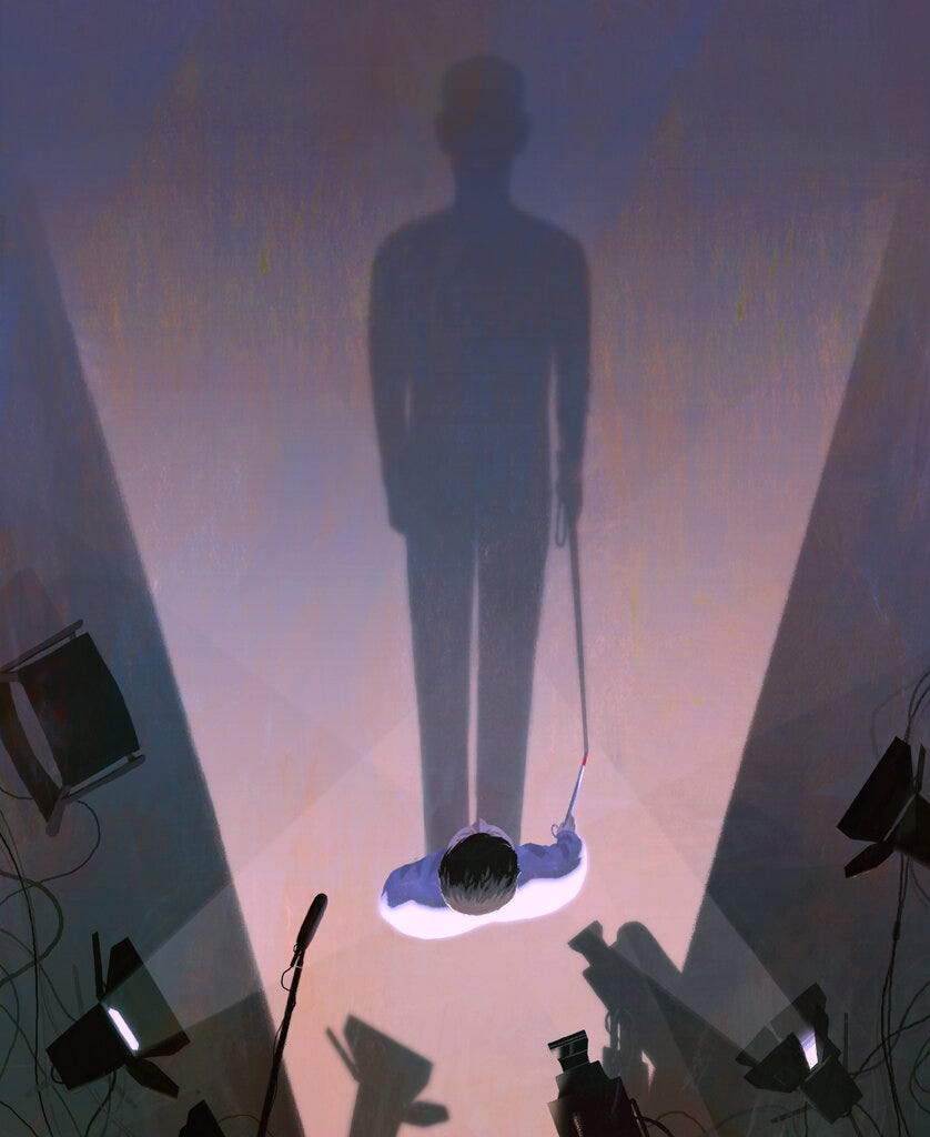 Illustration of a man holding a white cane with a red tip standing on a TV set whose lights project his long shadow across the floor. Illustration by Dadu Shin