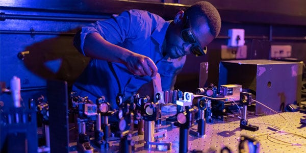 Isaac Nape, PhD student in quantum optics, setting up a quantum entanglement experiment in the Structured Light Laboratory at Wits University. CREDIT: WITS UNIVERSITY