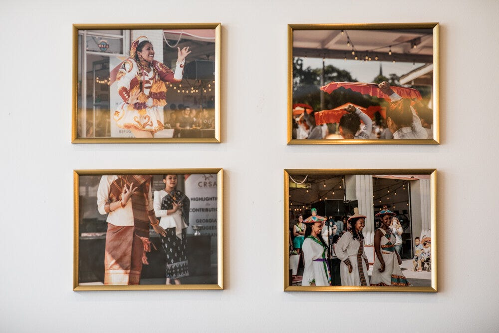 Four framed photographs on the wall at Refuge Coffee Co. in Sweet Auburn.