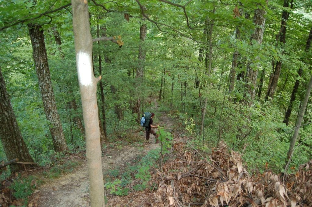 A backpacker depends down the Knobstone Trail in southern Indiana. Photo by author