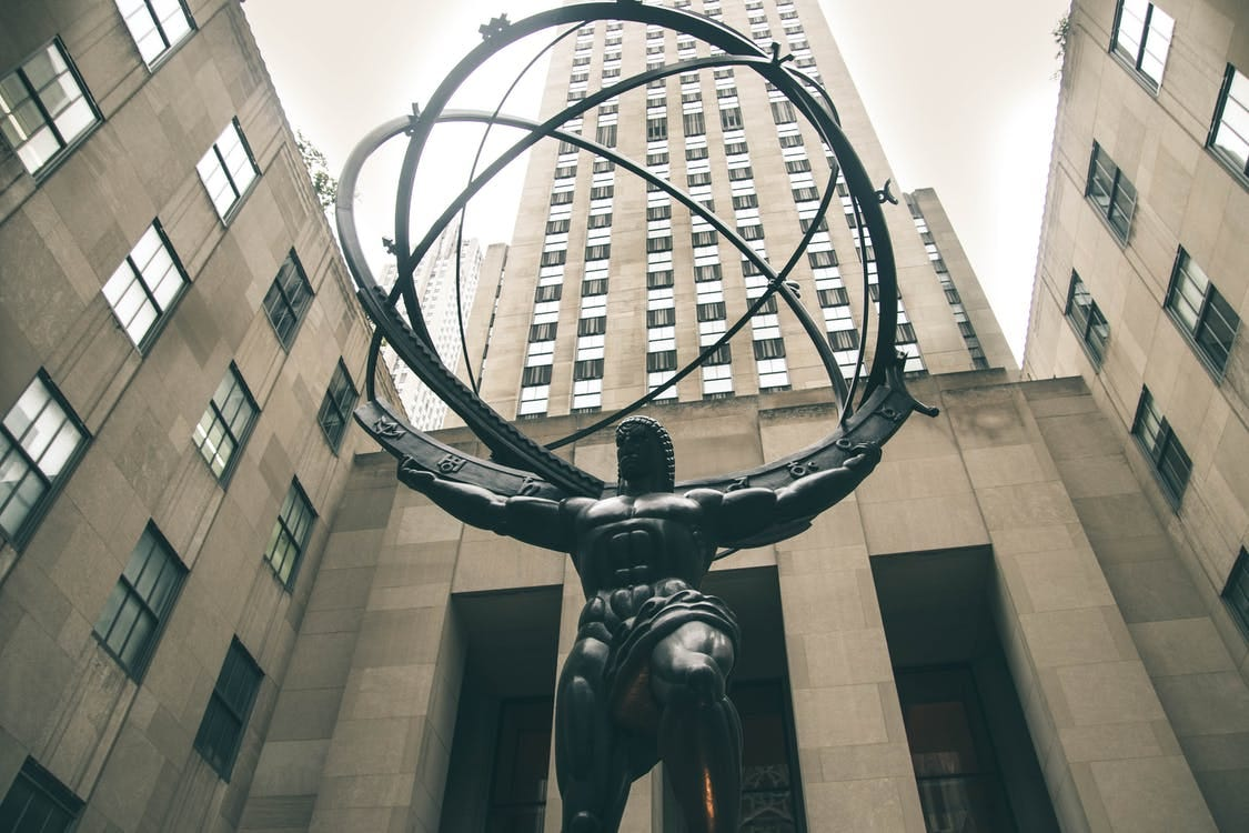 Low-angle Photography of Atlas Statue