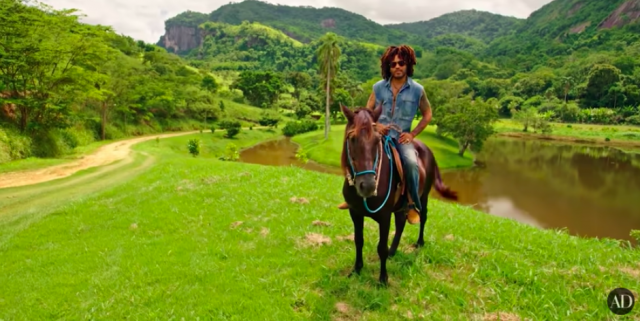 Lenny Kravtiz atop a horse, in his working farm in Brazil.