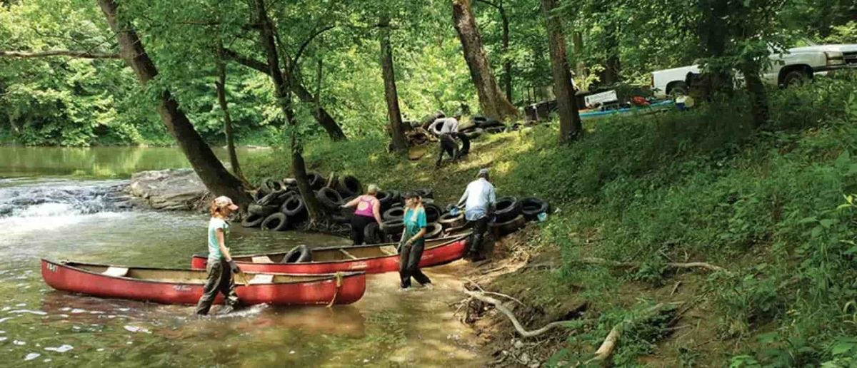 volunteers remove tires from the clinch river in virginia