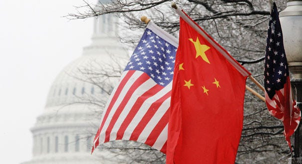 The American and Chinese flags are seen. | AP Photo
