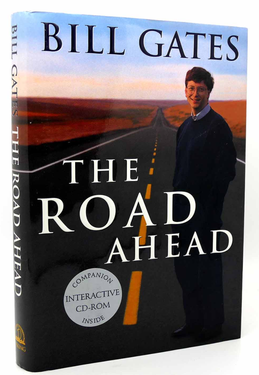 """Book cover """"The Road Ahead"""" by Bill Gates (1995). The photo is bill alone on a stretch of highway."""