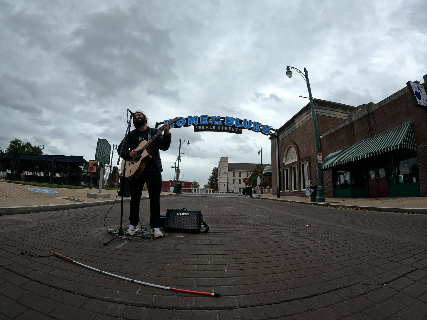 Anthony live streaming in the middle of the road on Beale Street in Memphis, TN