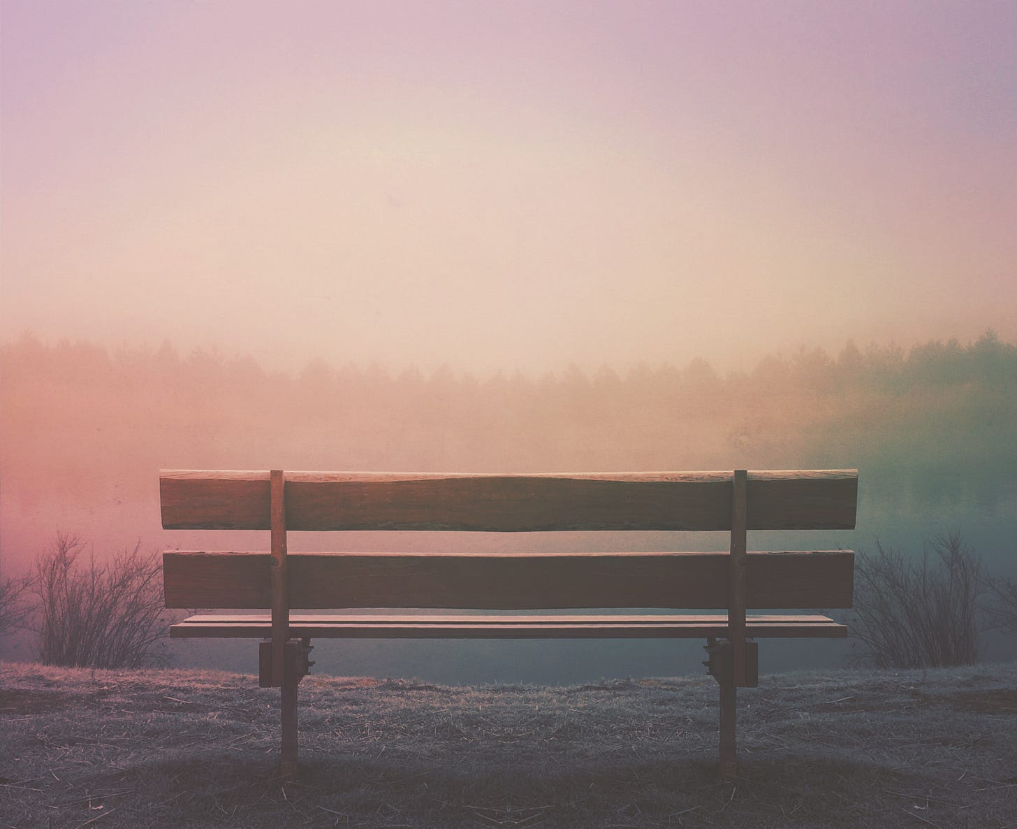 bench in front of sunset