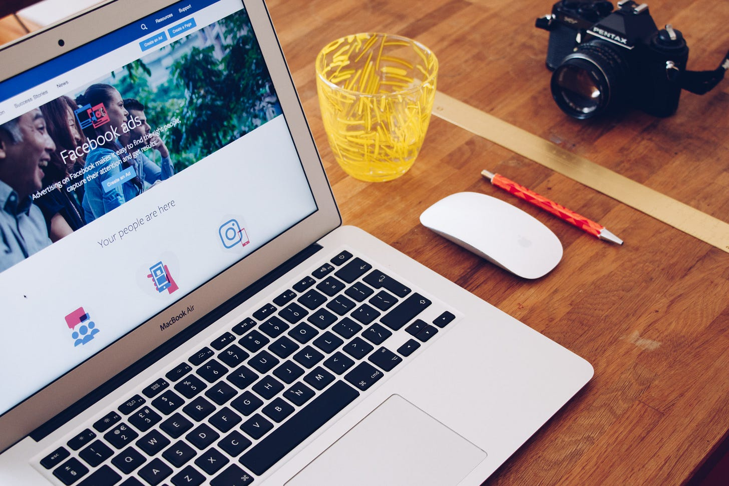 Facebook ads shown on a Macbook Pro. Will Francis / Unsplash