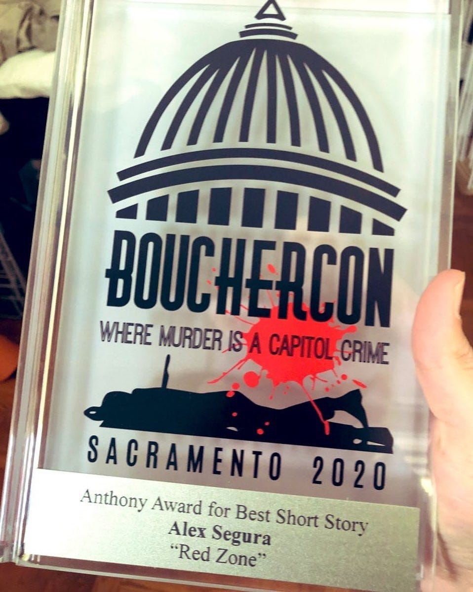 """Image may contain: text that says 'BOUCHERCON WHERE MURDER_ISA CAPITOL CRIME SACRAMENTO 2020 Anthony Award for Best Short Story Alex Segura """"Red Zone""""'"""