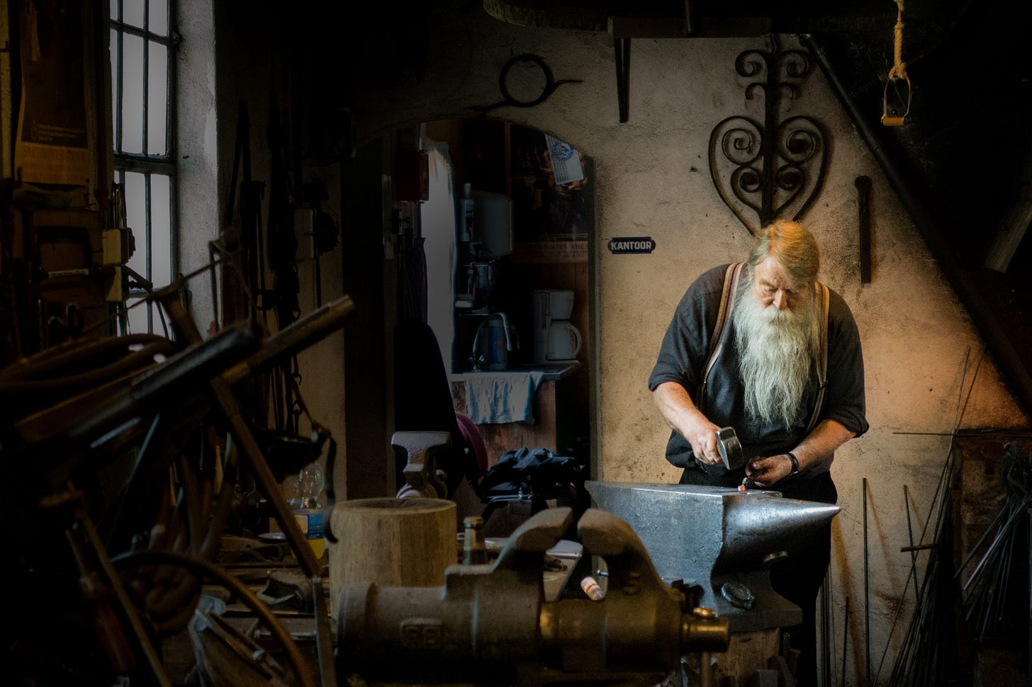 image of a craftsman at work for article by Larry G. Maguire