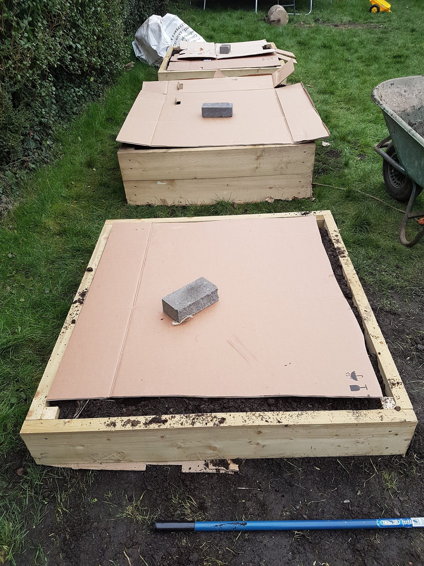 Photo of my raised beds, filled with soil and protected with cardboard