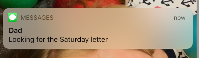 """Screenshot of a text message from """"Dad"""": """"Looking for the Saturday letter"""""""