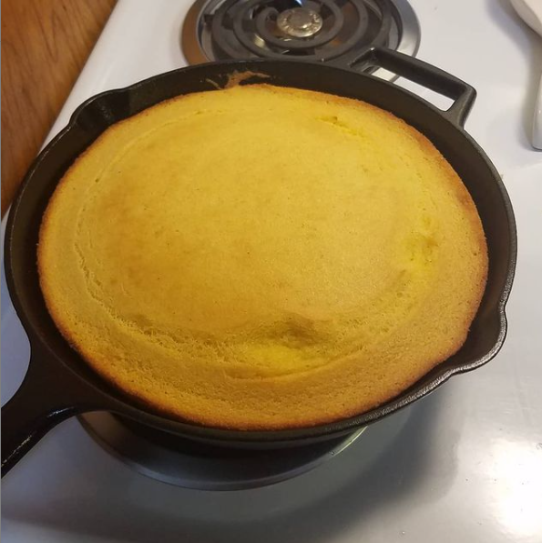 My cornbread from new year's 2020. It is in a 10-inch cast iron pan on a white stove.