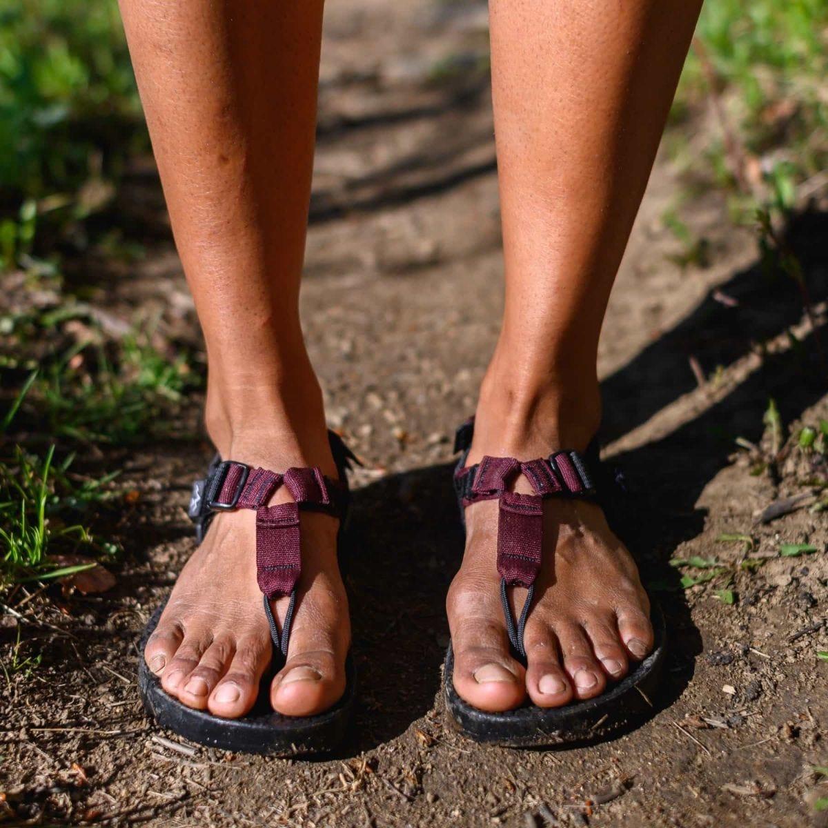 a man wearing bedrock cairn sandals