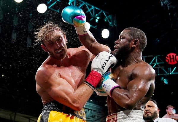 Floyd Mayweather Jr., right, said he did not plan to carry the torch for boxing in future bouts. Logan Paul said he expected to fight more often.