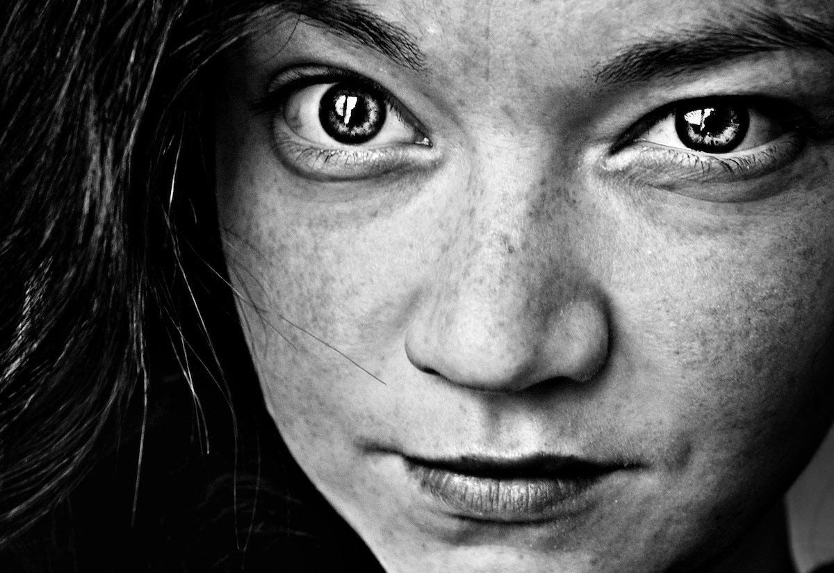 black and white photo of a girl's face for article by Larry G. Maguire
