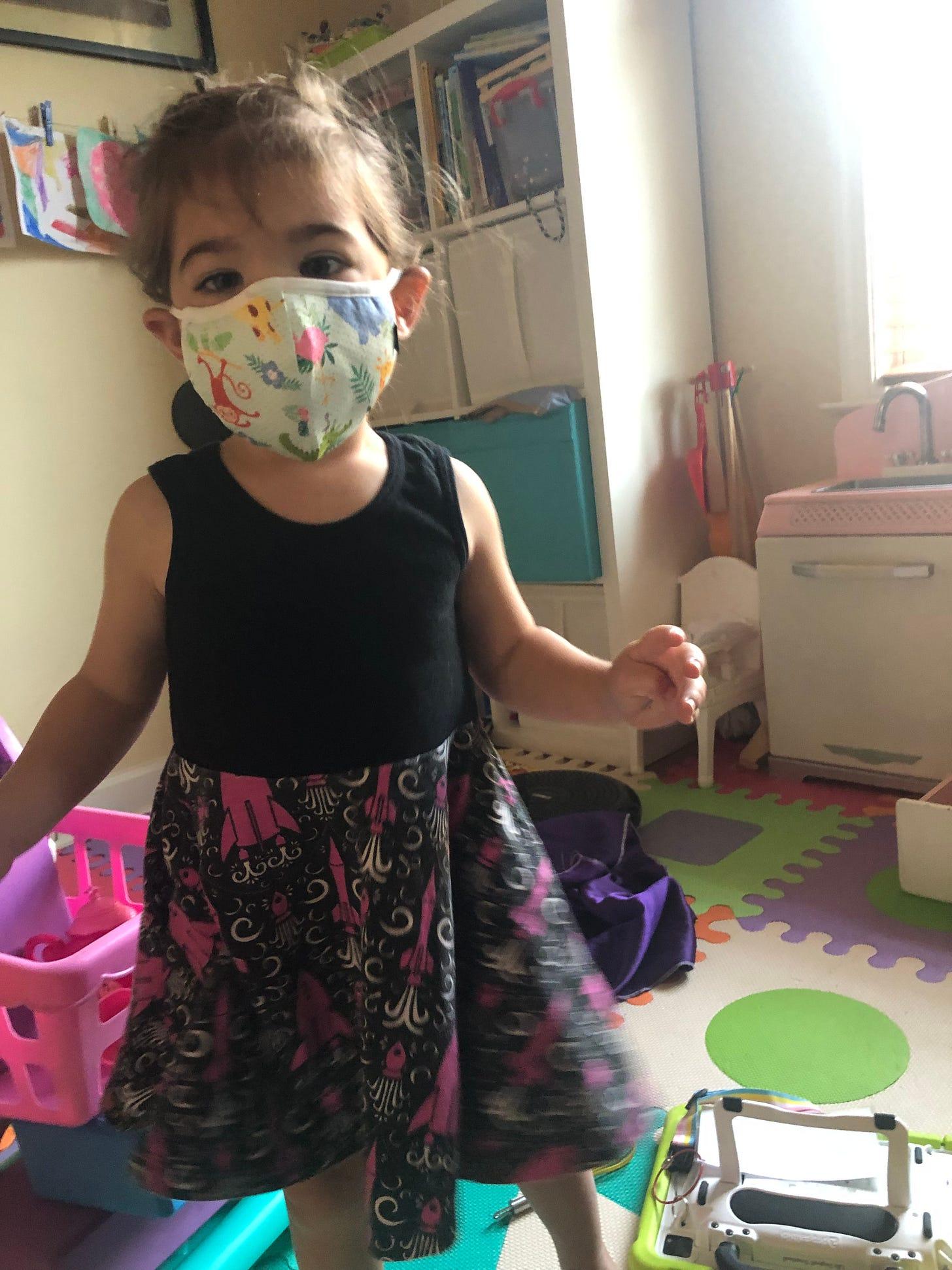 Photo of Lila wearing a mask.