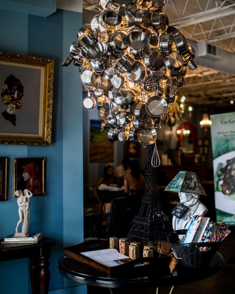 The pots & pans chandelier at Amélie's Bakery in Atlanta.