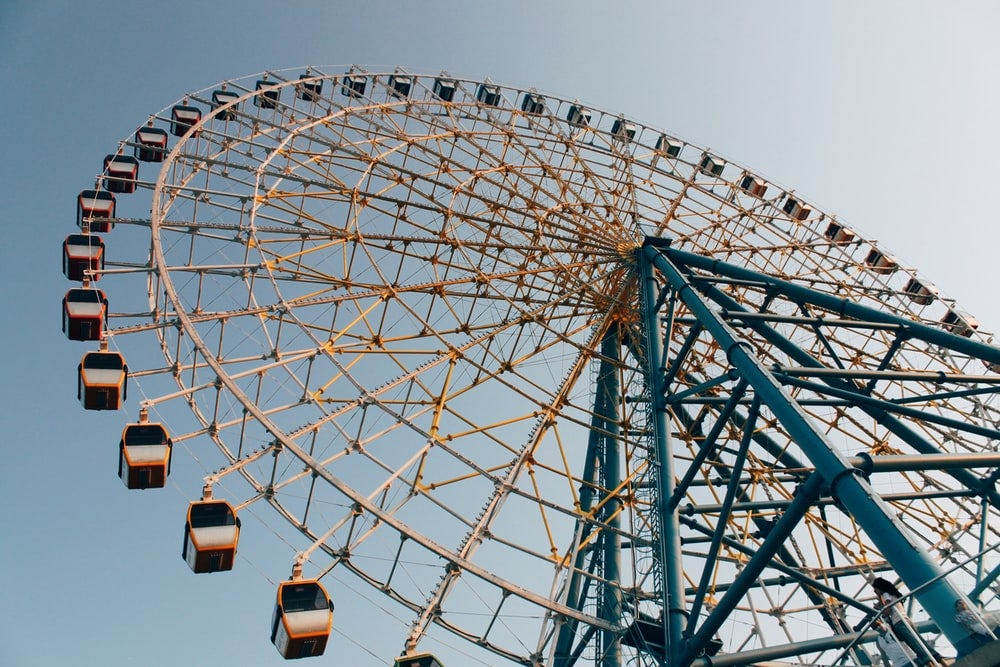 white and blue ferris wheel