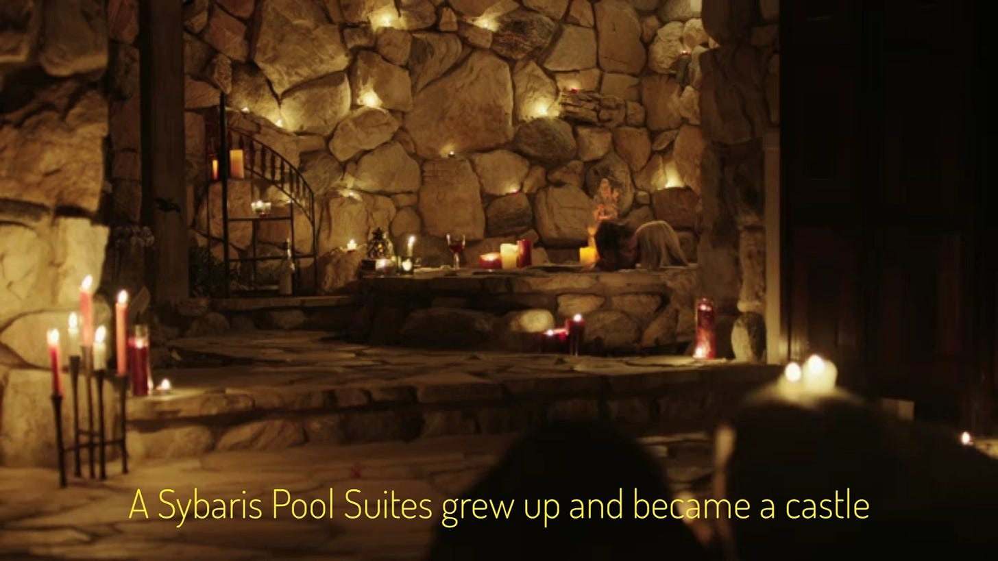 """ID: a stone room with lots of candles and a stone hot tub, with two white people smooching in it. Captioned """"A Sybaris Pool Suites grew up and became a castle."""""""