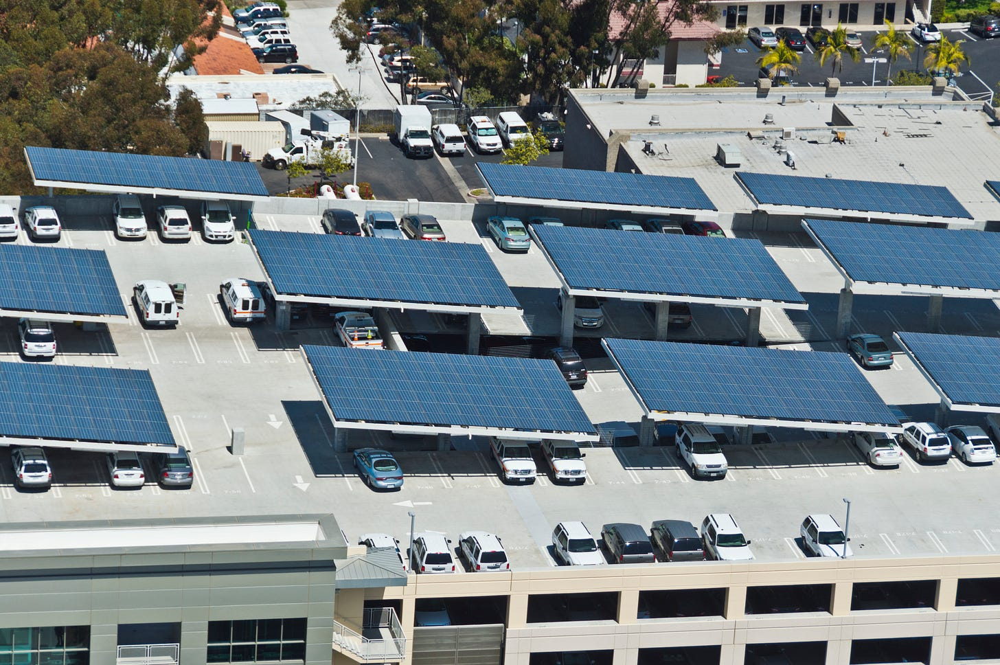 Some distributed solar covering a parking lot. (Photo: Getty Images)