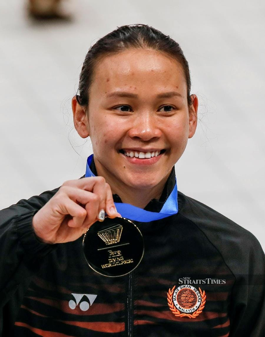 Pandelela Rinong with her gold medal after winning the women's 10m platform final at the Diving World Cup in Tokyo. EPA PIC