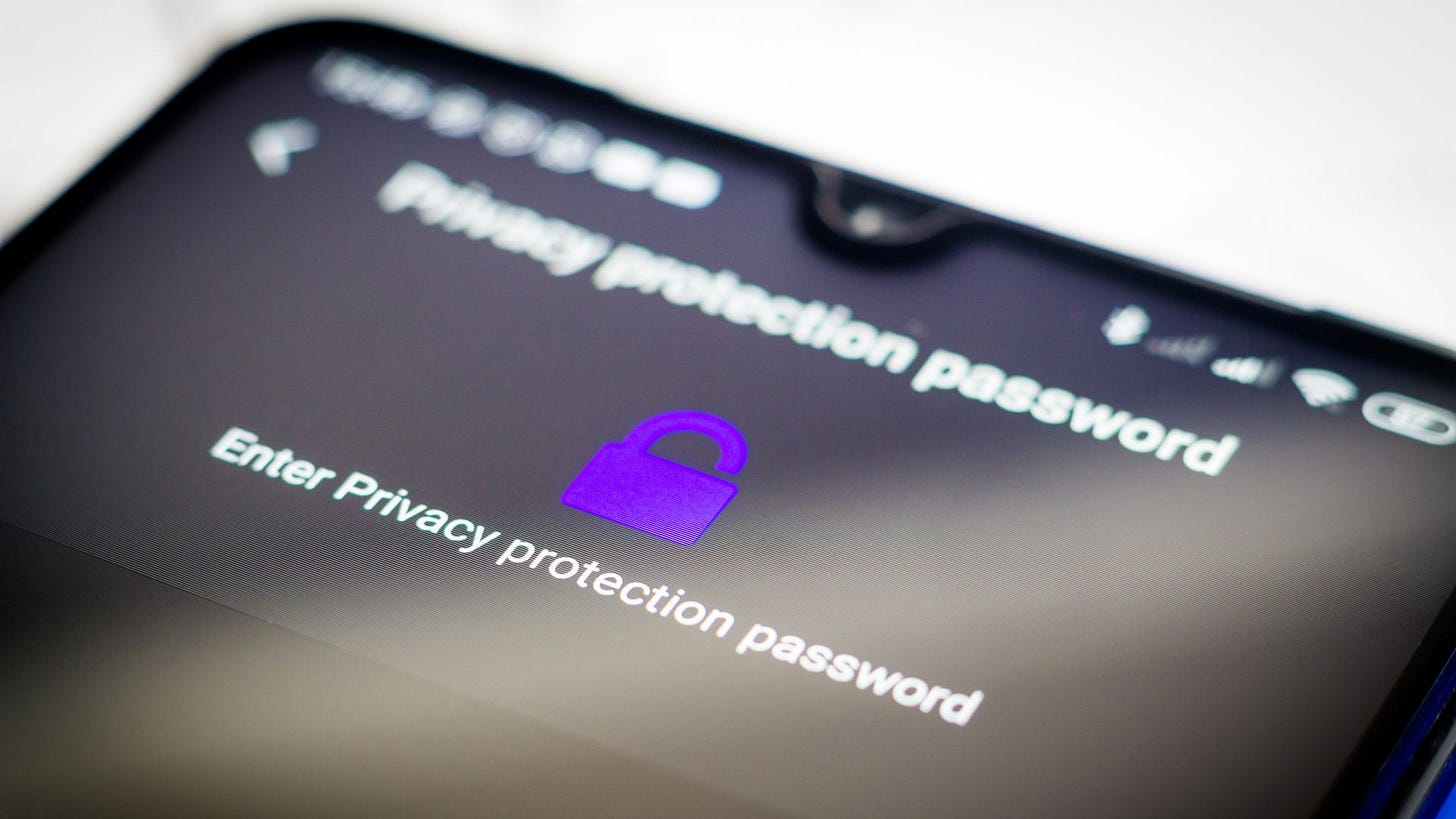 A photo of a smartphone depicting a password screen for a privacy protection feature