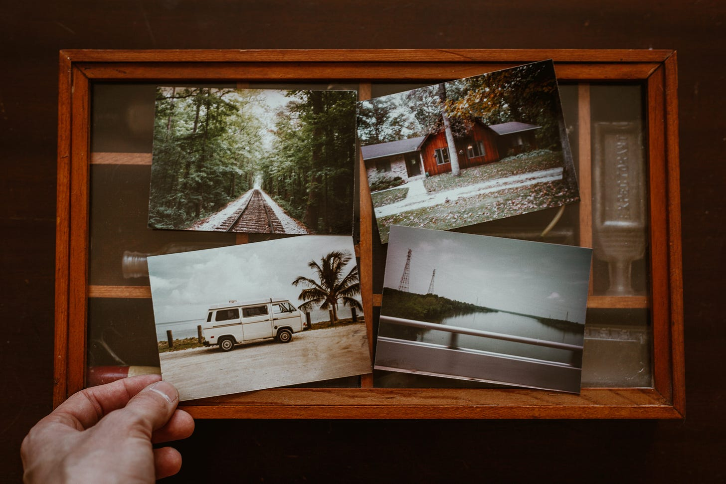 a person holding four photos