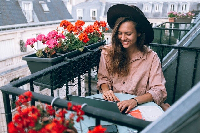 Woman working from home in Paris