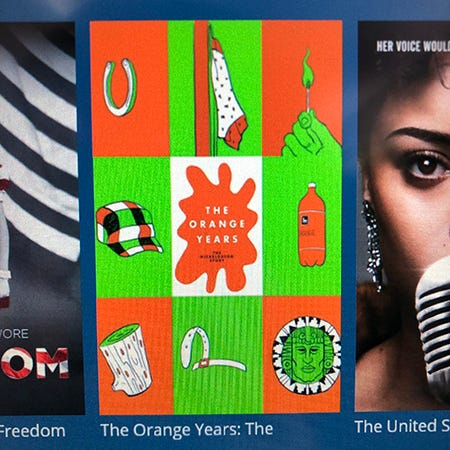 """A shitty photo of the thumbnail image for """"The Orange Years"""" documentary about Nickelodeon as seen on the touch screen monitor in the back of the seat in front me on a Delta airplane."""