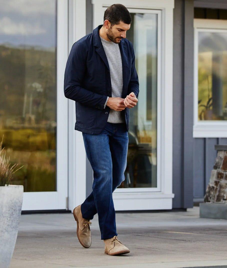 a man wears the relwen flex field blazer while walking in the summer