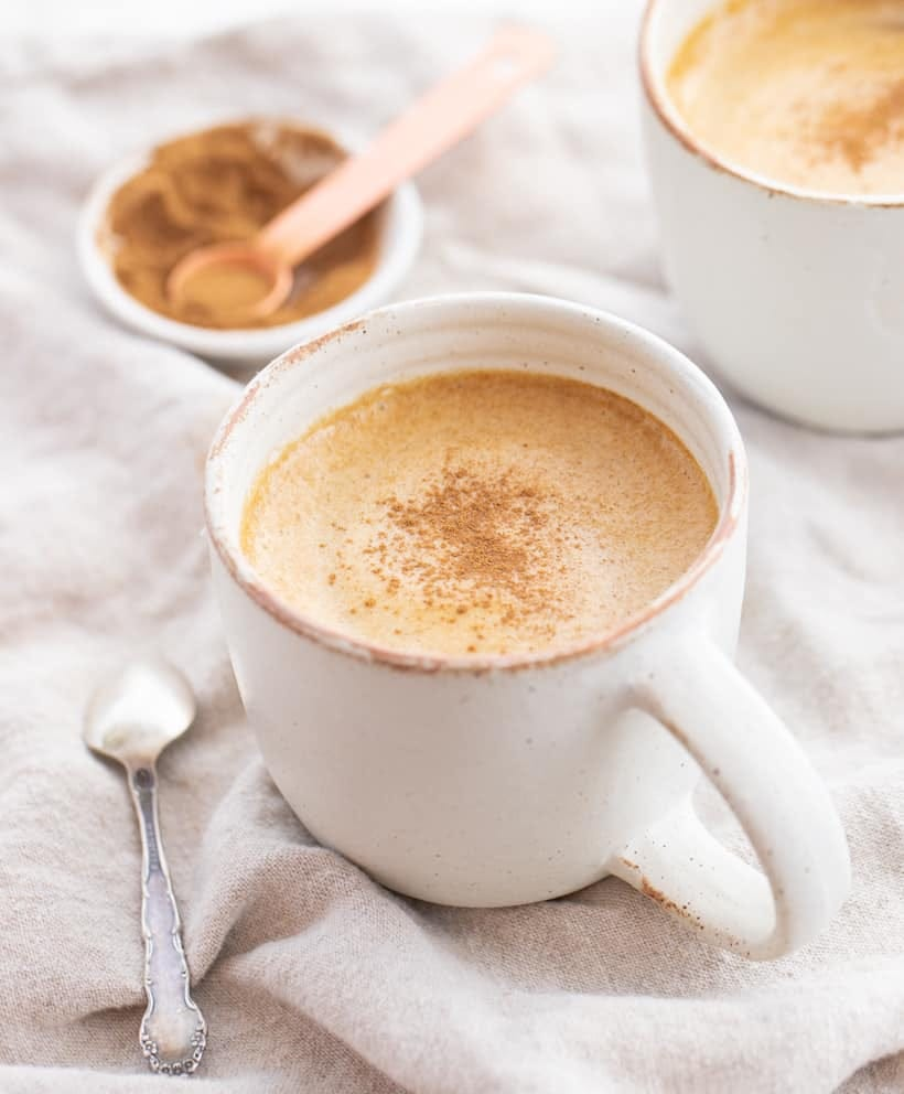 pumpkin spice latte in a white mug, topped with nutmeg