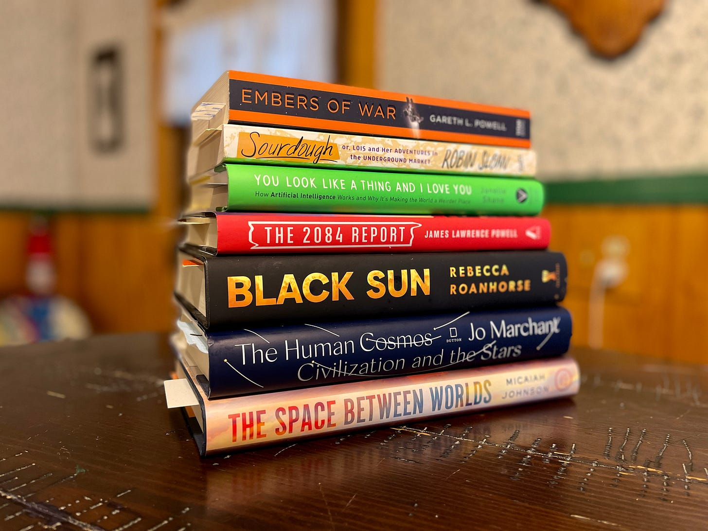 A stack of books on a table.