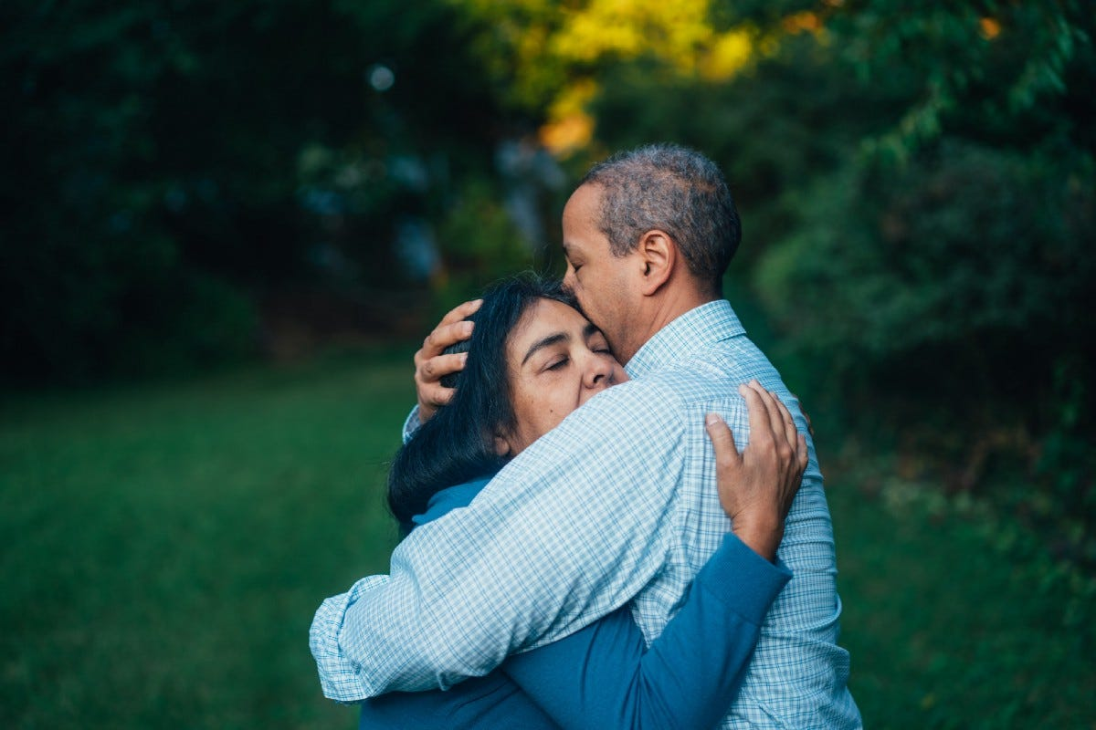 A man and a woman hugging