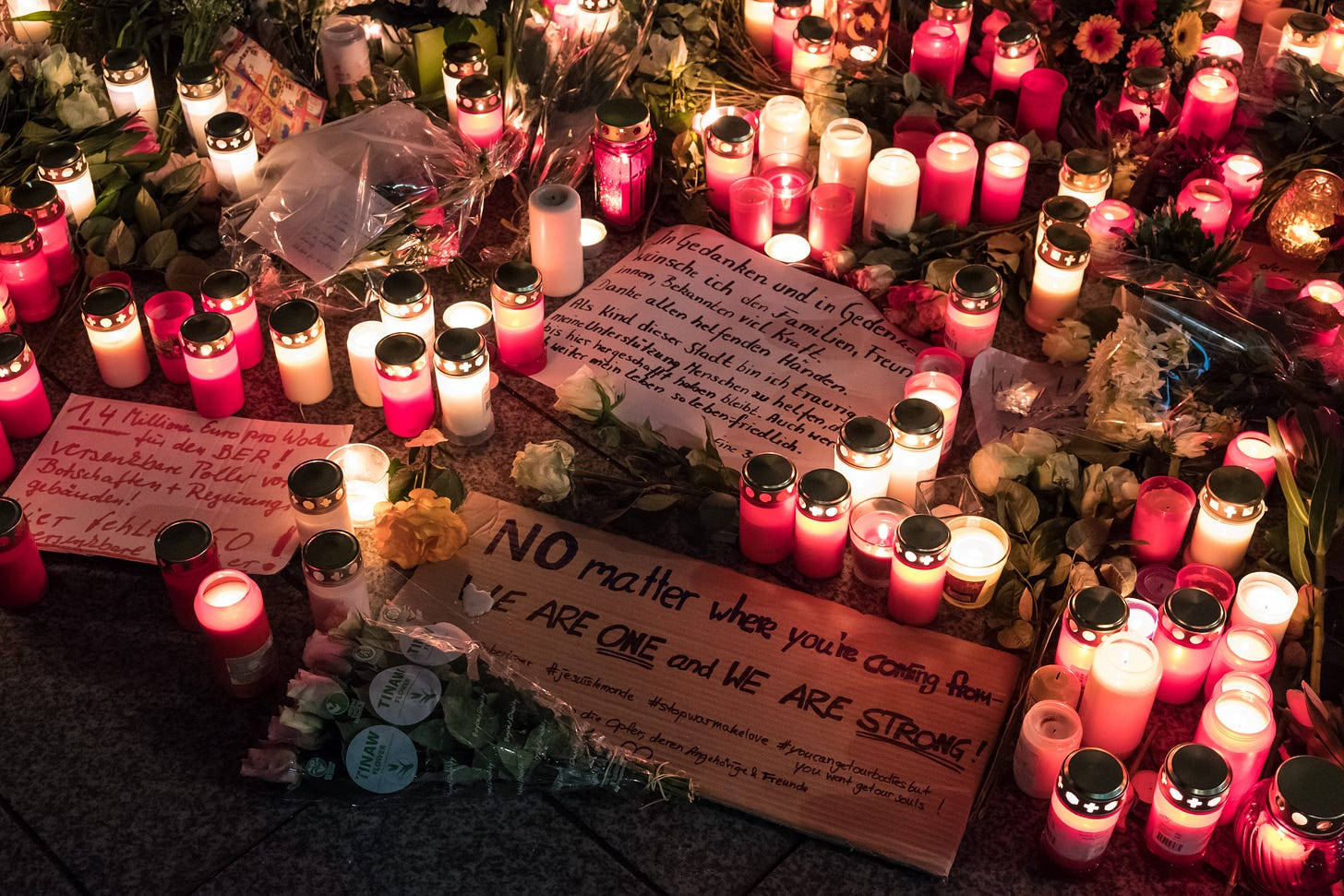 DECEMBER 21, 2016 - BERLIN: flowers and candles after the terror attack on the christmas holiday market a day before, Breitscheidplatz © hanohiki / shutterstock