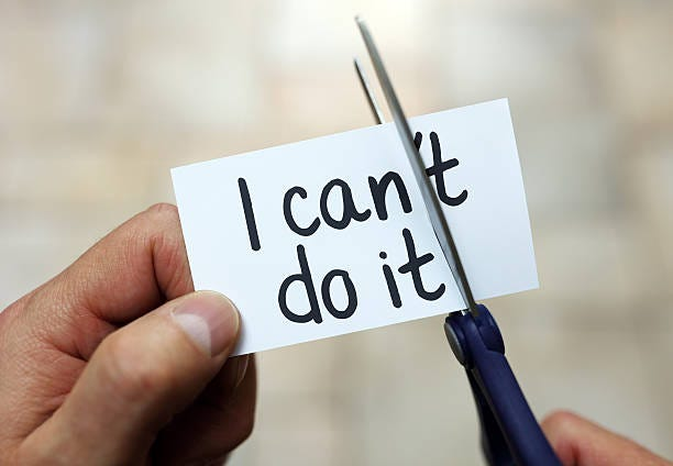 I can do it Man using scissors to remove the word can't to read I can do it concept for self belief, positive attitude and  motivation overcome stock pictures, royalty-free photos & images