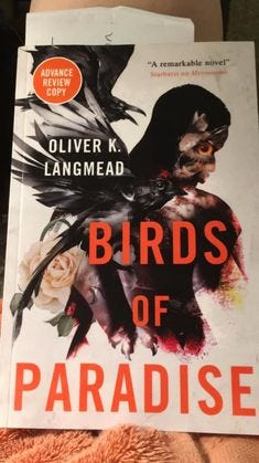 """Image may contain: one or more people, text that says 'ADVANCE REVIEW COPY """"A remarkable novel"""" Starburst on Metranume OLIVER K. LANGMEAD BIRDS OF PARADISE'"""