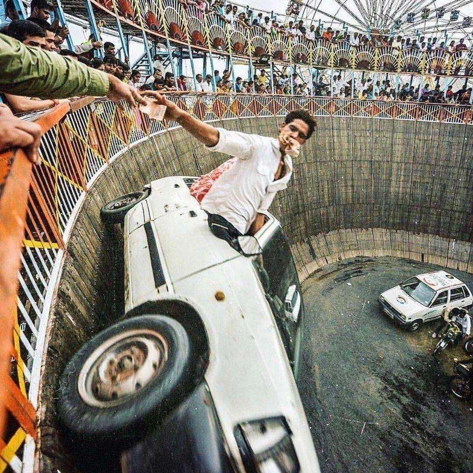 r/pics - Getting paid on the Wall of Death in Rajkot, India