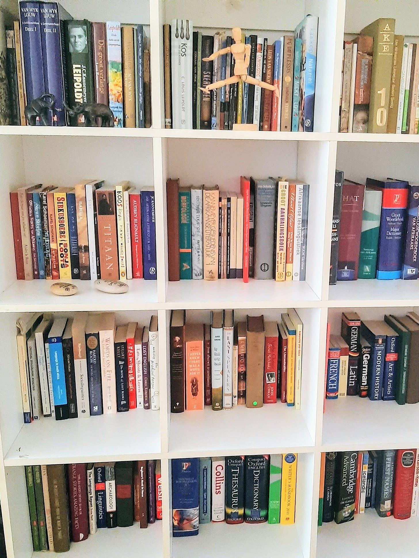 white bookshelf filled with books