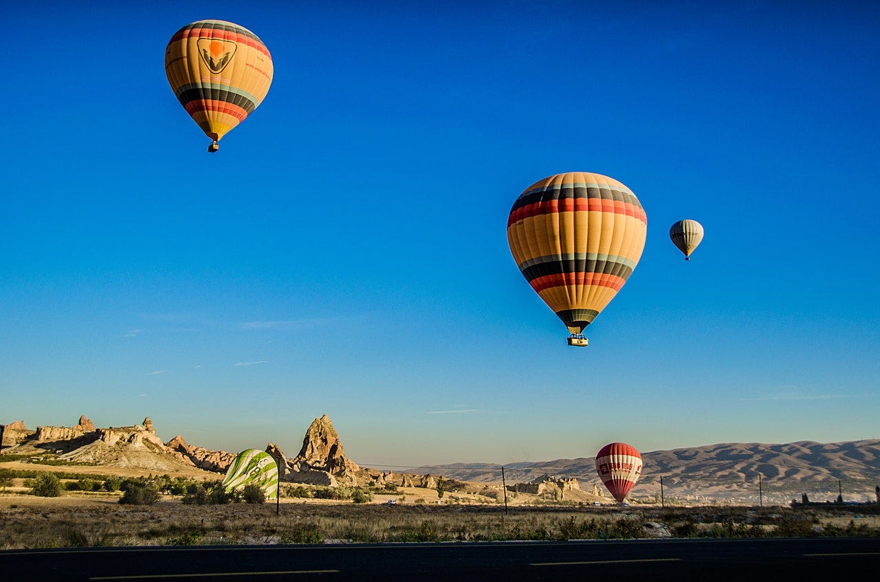 Beautiful photo of hot air balloons over the desert.