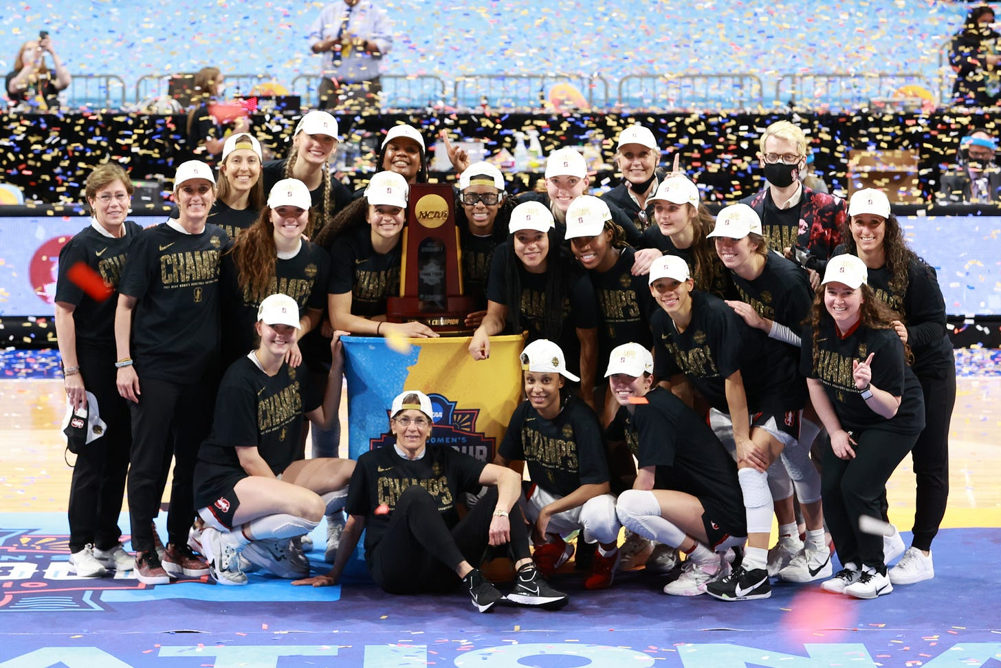 SAN ANTONIO, TX - APRIL 4: Stanford Cardinal players pose with the championship trophy after defeating the Arizona Wildcats in the championship game of the NCAA Women's Basketball Tournament at Alamodome on April 4, 2021 in San Antonio, Texas. (Photo by Justin Tafoya/NCAA Photos via Getty Images)