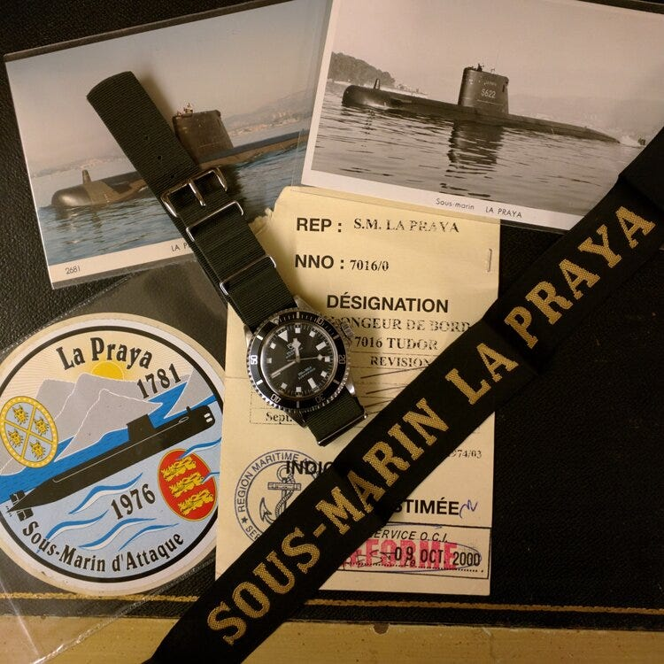 © WATCHISTRY | A Tudor Submariner ref. 7016 on top of its decommission papers. This particular example was issued to the attack submarine  La Praya , a fast-attack sub built by France in the 1970s.