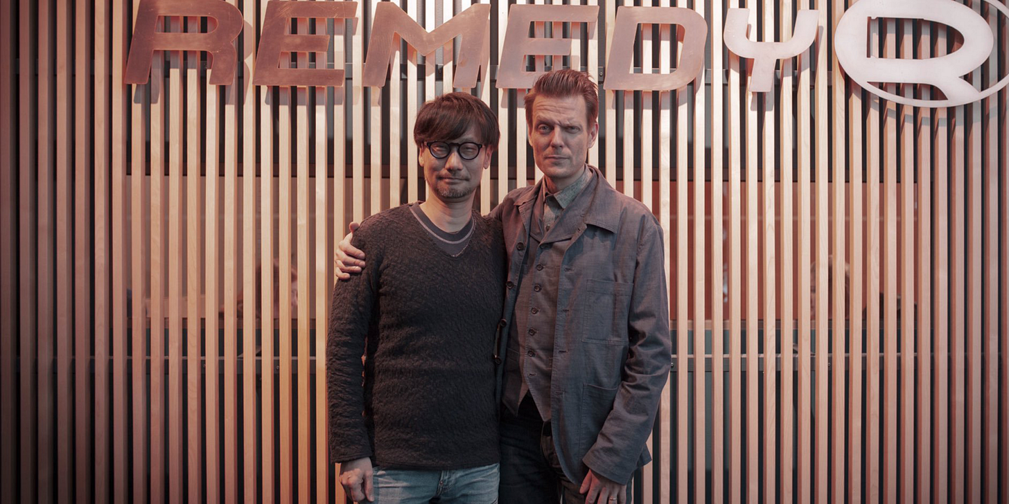 Hideo Kojima and Sam Lake standing together at Remedy's HQ. (with Remedy's logo visible)