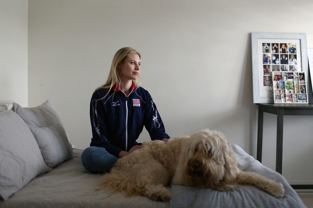 Hayley Hodson sits with her dog, Buddy, at her parents' Newport Beach home.