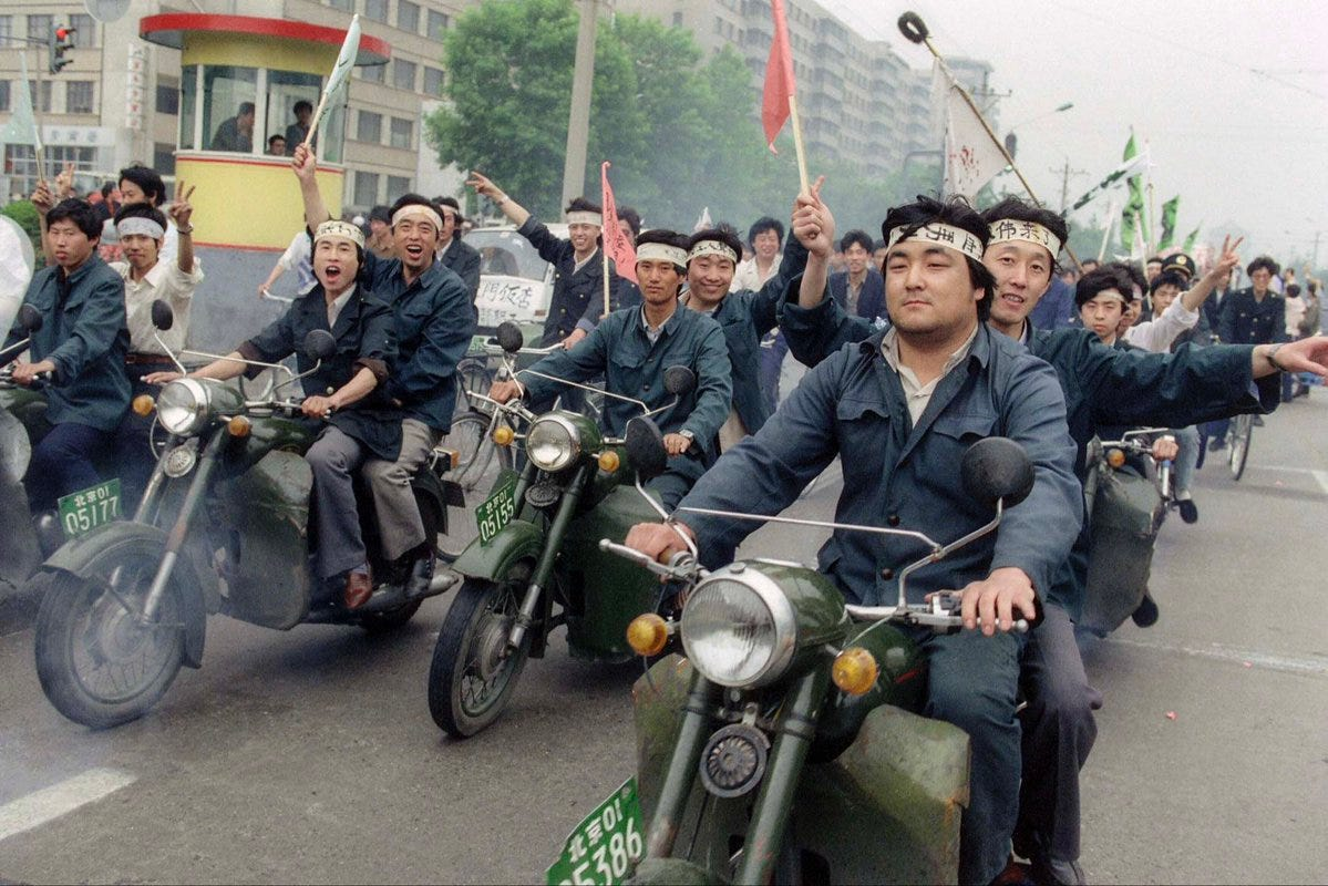 Factory workers on Their Way to Tiananmen Square, Beijing 1989 - by Catherine Henriette/AFP/Getty