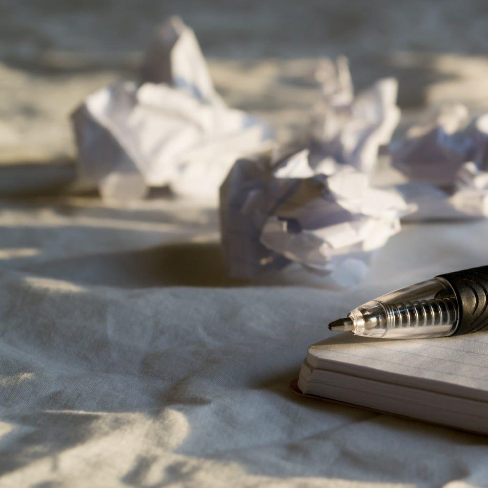 silver pen on white paper