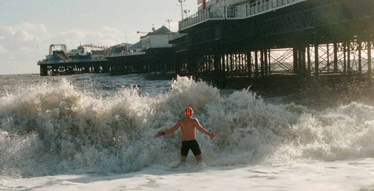 man enters the cold waves of the english channel